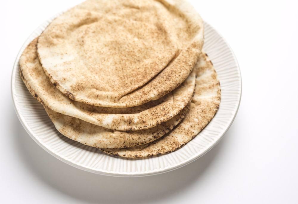 صورة طريقة عمل الخبز اللبناني , الخبز اللبناني الشهي بتكاته وحركاته السرية